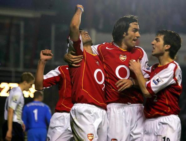 Arsenal's Jose Antonio Reyes (L) is cong