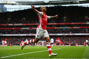 Theo Walcott celebrates scoring against Aston Villa