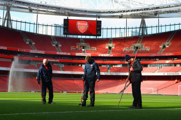 LONDON, ENGLAND - FEBRUARY 22: Groundsmen tend to the pitch ahead of the Barclays Premier League match between Arsenal and Sunderland at the Emirates Stadium on February 22, 2014 in London, England. (Photo by Michael Regan/Getty Images)